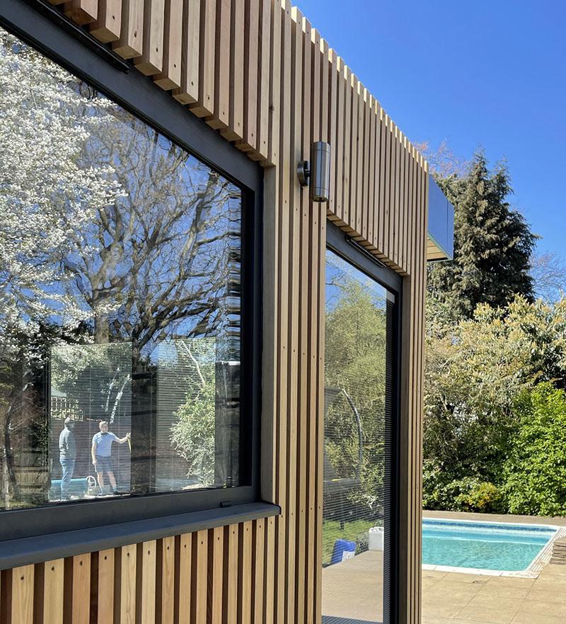 pool studio larch spaced cladding